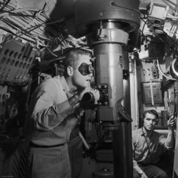 american-submarine-captain-peering-through-ship-s-periscope-searching-for-japanese-shipping